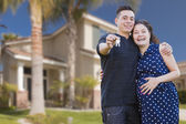 Hispanic Couple with House Keys In Front of New Home — Foto de Stock