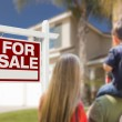 Family Facing For Sale Real Estate Sign and House — Stock Photo