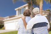 Happy Senior Couple Looking at Front of House — Foto Stock