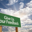 Give Us Your Feedback Green Road Sign — Stock Photo