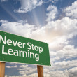Never Stop Learning Green Road Sign — Stock Photo #48964383