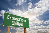 Expand Your Skillset Green Road Sign — Stock Photo