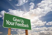 Give Us Your Feedback Green Road Sign — Photo