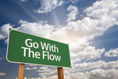 Go With The Flow Green Road Sign — Stock Photo