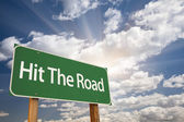 Hit The Road Green Road Sign — Stock Photo