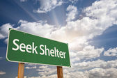 Seek Shelter Green Road Sign — Stock Photo