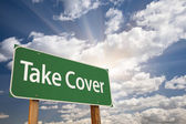 Take Cover Green Road Sign — Stock Photo