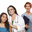 Hispanic Female Doctor with Child Patient and Colleague — Stock Photo #6583488