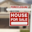 Foreclosure House For Sale Sign and House — Stock Photo #9433511