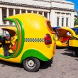 Stock Photo: Small taxis known as Cocotaxis in Havana