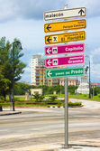 Signpost with directions to landmarks in Havana — Stok fotoğraf
