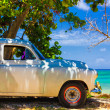 Vintage car at a beach in Cuba — Stock Photo