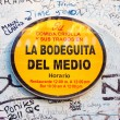 Stock Photo: Sign with graffitti at La Bodeguita del Medio in Havana