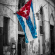 Cuban flag in a shabby street in Havana — Stock Photo #12759231