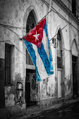 Cuban flag in a shabby street in Havana — Stock Photo