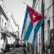 Cuban flag in a shabby street in Havana — Stock Photo #12773289
