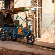 Royalty-Free Stock Photo: Bycicle in a shabby Havana neighborhood