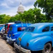 Stock Photo: Vintage cars near Capitol of Havanin Cuba