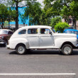 Old car in front of several other vintage vehicles in Havana — Stock Photo