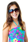 Hispanic girl wearing a swimsuit and sunglasses — Stock Photo