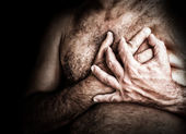 Shirtless man suffering from chest pain — Stock Photo