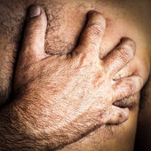 Close-up of a hand grabbing a chest — Stock Photo