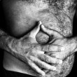 ������, ������: Man suffering from severe abdominal pain