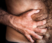 Man suffering from severe abdominal pain — Stock Photo