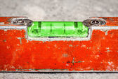 Used and dirty spirit level on a concrete wall — Stock Photo