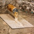 Old trowel above a concrete surface — Stock Photo