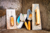 Masonry tools on a concrete surface — Stock Photo
