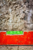 Dirty spirit level on a concrete surface — Stock Photo