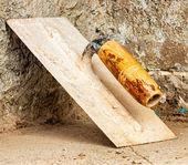 Trowel on a concrete wall — Stok fotoğraf