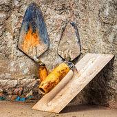 Masonry tools on a concrete wall — Stock Photo