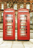 The famous red phone cabins in London — Stock Photo