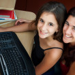 Hispanic mother and her daughter working on a computer — Stockfoto