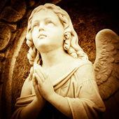 Praying angel in sepia shades — Stock Photo