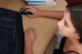 Cute latin girl working on her computer — Stock Photo