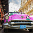 Vintage american car near El FLoridita in Havana - Stock Photo