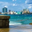 The skyline of Havana with a turbulent sea - Stock Photo
