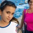 Girl and her mother by the seaside in Havana — Stock Photo #14154257