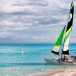 Stock Photo: Family of tourists going sailing in the cuban beach of Varadero