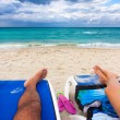 Couple resting on a tropical cuban beach - Stock Photo