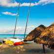 Royalty-Free Stock Photo: Sailing boats and umbrellas at a beach in Cuba