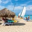 Tourists enjoying the beach of Varadero in Cuba - Stock Photo