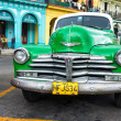 Vintage green Chevrolet in Havana — Stock Photo #16184747
