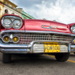 Stockfoto: Low angle view of old red Chevrolet in Havana