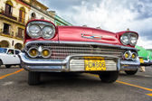 Low angle view of an old red Chevrolet in Havana — Stock Photo