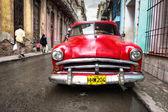 Old red car in a shabby street in Havana — Stock Photo