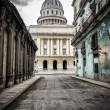 Street with crumbling buildings leading to the Capitol in Old Ha — Stock Photo #16354733